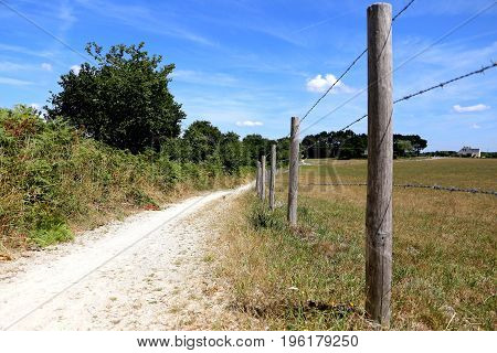 Walking track along the fields of rural brittany