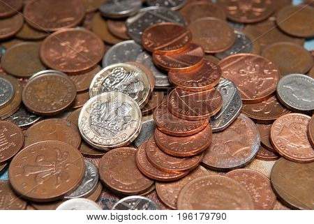 Pile Of English Currency Coins, Pounds And Pence