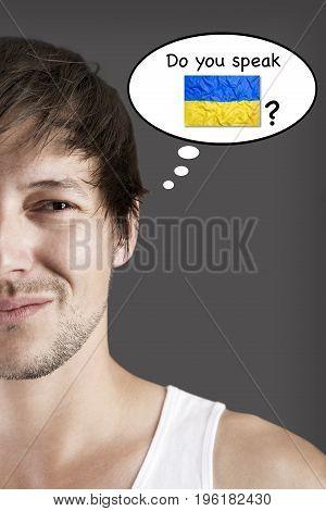 Handsome student thinks do you speak Ukrainian?