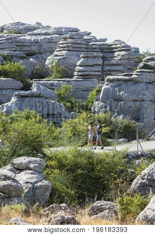 Antequera Spain - July 14 2017: visitors walking by Torcal Natural Park trail Malaga Spain