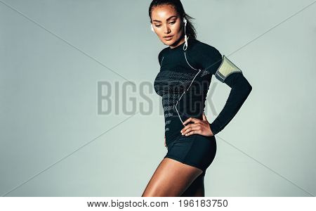 Fitness Woman Listening To Music With Earphones