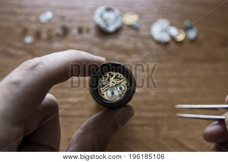 Watch repair with using magnifying glass watchmaker's workshop