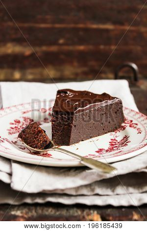 Homemade chocolate brownie cake with chocolate cream on a dessert plate, selective focus