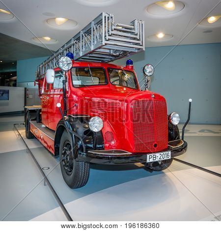 STUTTGART GERMANY- MARCH 19 2016: Firefighter car Mercedes-Benz LF3500 with Metz turntable ladder 1952. Mercedes-Benz Museum.