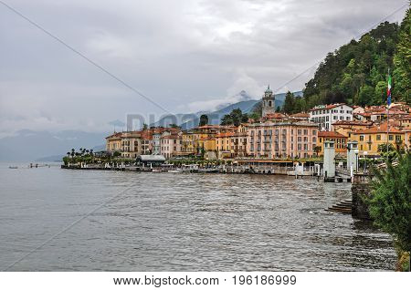 View of Lake Como in cloudy day with the buildings of Bellagio, a charming tourist village between the lake and the mountains of the Alps. Located in the Lombardy region, northern Italy