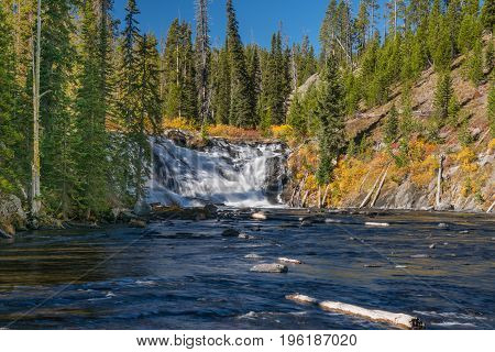 Lewis Falls along the Lewis River in Yellowstone National Park Wyoming