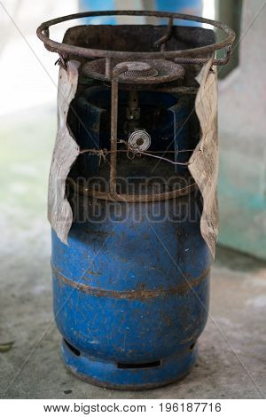 dirty and old gas tank in blue color