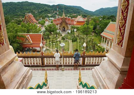 PHUKET, THAILAND - APRIL 27, 2010: Unidentified people visit Chalong Temple at Phuket island, Thailand.