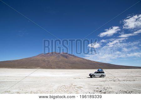 Uyuni, Bolivia - November 02, 2015: A jeep driving on the famous salt flats of the Salar de Uyuni