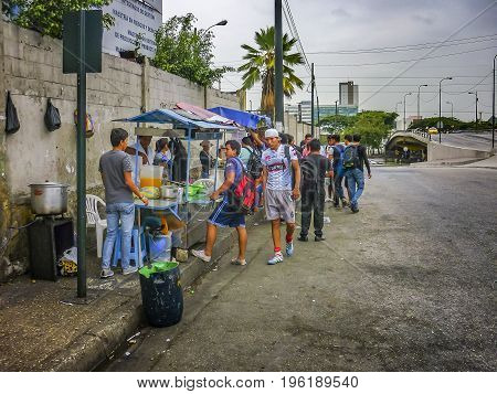 GUAYAQUIL, ECUADOR, NOVEMBER - 2016 - Stop bus with street vendors and young people in Guayaquil Ecuador