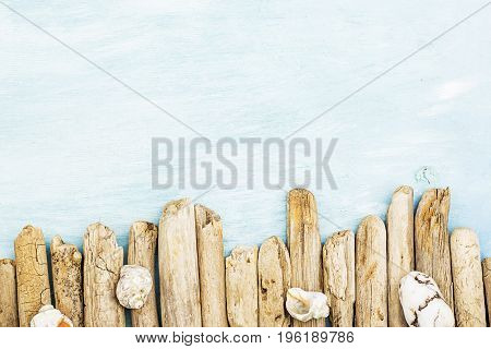 Summer background, driftwood marine items, sea objects on turquoise blue wood with copy space.