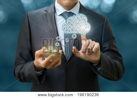 The Businessman Downloads Data From The Cloud .