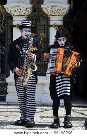 Aveiro Portugal - June 10 2017: Street musicians perform a show on the street in Aveiro. Aveiro is one of the most popular tourist cities in Portugal