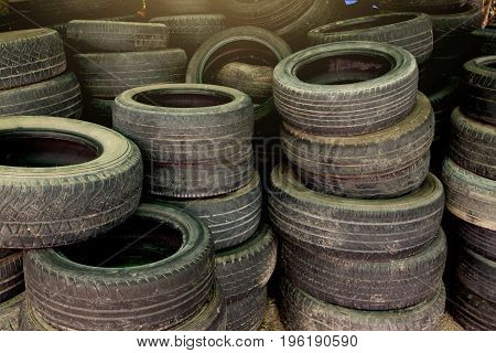 Stack lot of used old tires for donate and reuse..