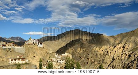 View on the beautifully located Buddhist monastery in the Lamayuru village in the background one can see the mountains Ladakh is admiring the beautiful Karakorum panorama. Local are naming this rock formation with