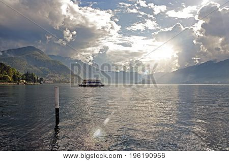 View of Lake Como in a cloudy day with boat in the foreground in Bellagio, a charming tourist village between the lake and the mountains of the Alps. Located in the Lombardy region, northern Italy