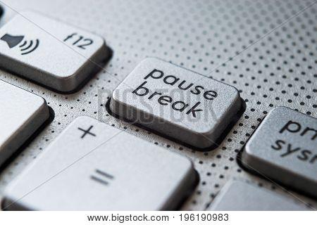 Pause Break aluminium button on the laptop keyboard
