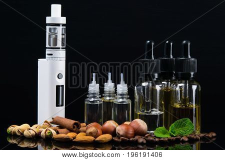 Liquid for an electronic cigarette in bubbles surrounded by nuts cinnamon and fresh mint