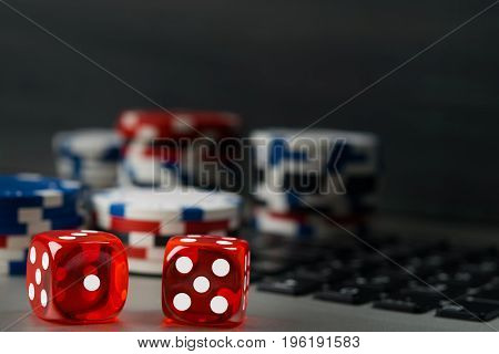 Gambling for money on the Internet in cards and dice background