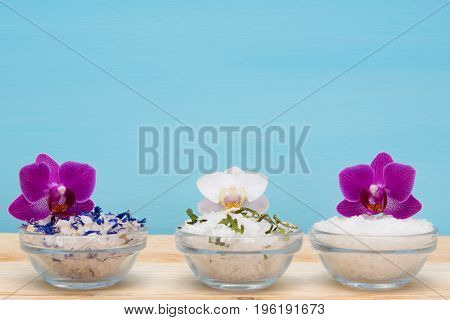 set of white salt with additives for spa treatments and orchids