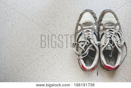 Vintage sport shoes top view. Sport background