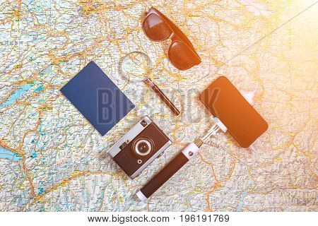 Travel plan, trip vacation accessories for trip, tourism mockup - Outfit of traveler on map background. Flat lay and copyspace. Still life. Sun flare