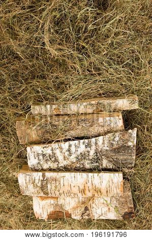 Natural background of hay and a set of firewood