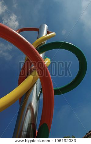 Milan, Italy - May 07, 2013. View of colorful modern sculpture with blue sky in the background at the city center of Milan, a large and modern city. Located in the Lombardy region, northern Italy