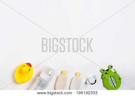 Baby accessories for bath with duck on white background. Top view. Copy space. Still life. Flat lay