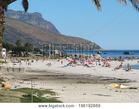 FROM CAPE TOWN, SOUTH AFRICA , CAMPS BAY BEACH, FILLED WITH HOLIDAY MAKERS ENJOYING THE SUN SHINE