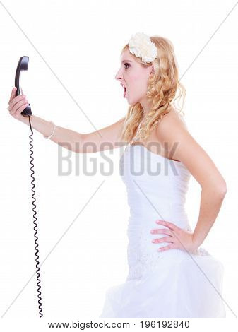 Relationship problems and troubles concept. Annoyed mad bride in white dress calling to somebody.