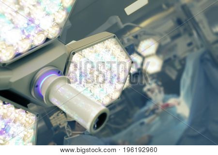 Surgical lamp on the background of surgery process.