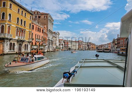 Venice, Italy - May 08, 2013. View of the Grand Canal with boats and buildings on the bank, at the city center of Venice, the historic and amazing marine city. Located in Veneto region, northern Italy
