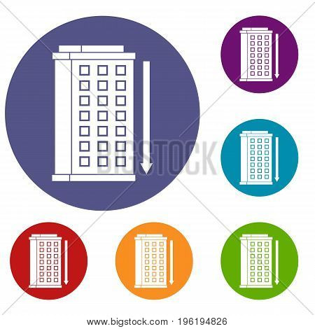 Tall building and down arrow icons set in flat circle red, blue and green color for web