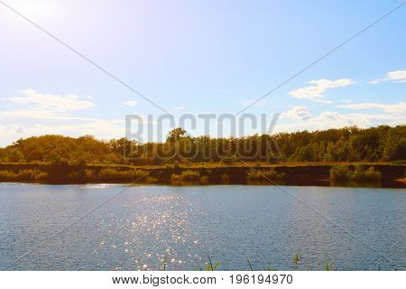 Landscape with clouds in blue sky over river