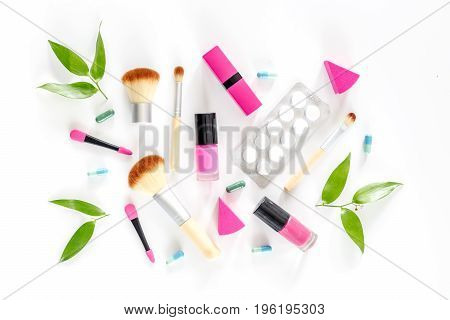 Contents of wonam's beauty bag. Cosmetics, contraceptives and pills on white background top view.