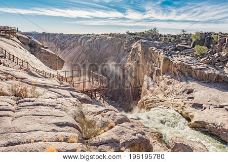 AUGRABIES FALLS NATIONAL PARK SOUTH AFRICA - JUNE 12 2017: A viewpoint and boardwalk at the top of the Augrabies main waterfall