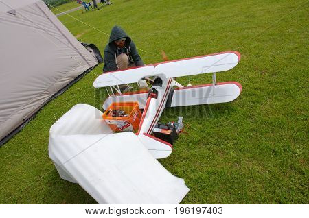 PENZA OBLAST, RUSSIA - JULY 15, 2017: Radio control flying model of biplane. The Russian Aeromodelling Cup in Bolshoy Vyas village.