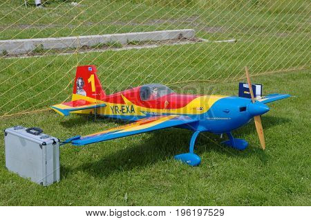 PENZA OBLAST, RUSSIA - JULY 15, 2017: Radio control flying model of Extra 330SC aircraft. The Russian Aeromodelling Cup in Bolshoy Vyas village.