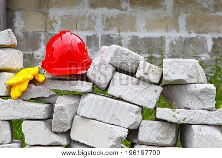 Construction.Masonry.The helmet and gloves.Objects and tools at industrial construction.