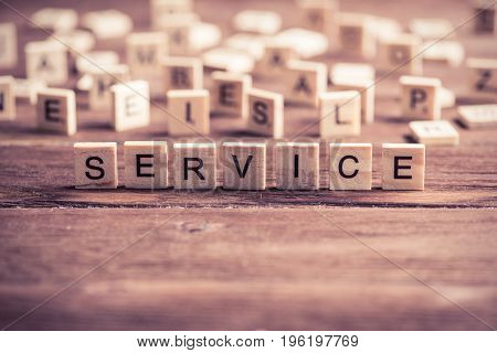 Business service word collected of elements of wooden elements with the letters