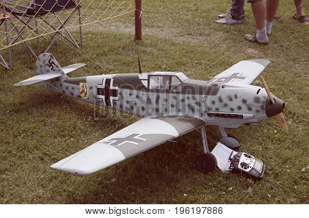 Penza Oblast, Russia - July 15, 2017: Radio control flying model of a Messerschmitt Bf 109. The Russian Aeromodelling Cup in Bolshoy Vyas village. Vintage toned photo.