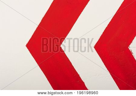 Red Arrow Indicates Direction To The Left Painted With Paint On A White Wall