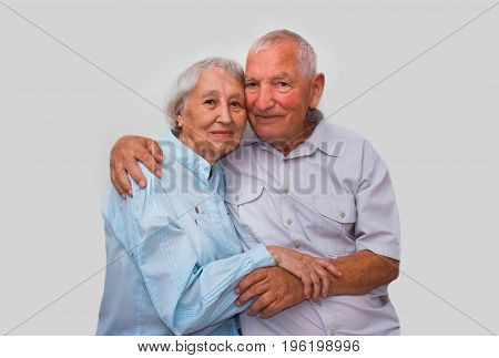 The happy elderly couple on the studio background