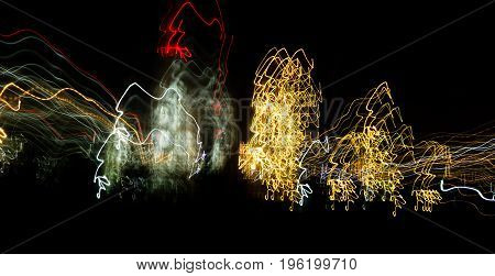 Abstract background of light bulbs at night in motion .