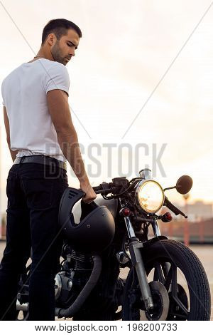 Brutal Man Near His Cafe Racer Custom Motorbike.