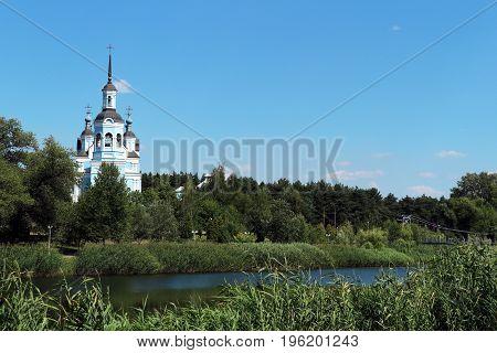 Orthodoxy Christian Church and footbridge on the riverside.