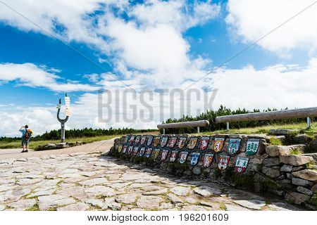 The place where the river Labe (Elbe) starts is called Labska Louka. It is located high in Giant Mountains. The cities symbols on the wall shows where the river flows.