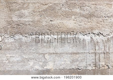 Fresh concrete on the wall as a background .