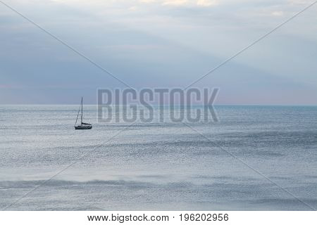 yacht in the sea rays from clouds landscape 2